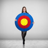 Business woman holding big target Stock Image