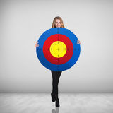 Business woman holding big target Royalty Free Stock Photography