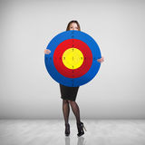 Business woman holding big target Royalty Free Stock Image