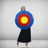 Business woman holding big target Stock Photos
