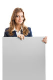 Business Woman holding a billboard Royalty Free Stock Photography