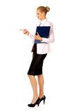 Business woman holding a binder and talking with someone Royalty Free Stock Image