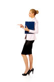Business woman holding a binder and talking with someone Stock Photos
