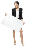 Business woman holding blank banner Royalty Free Stock Images