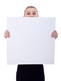 Business woman holding a blank billboard stock image