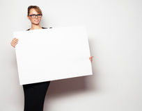 Business woman holding a blank billboard. Royalty Free Stock Photos