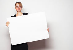 Business woman holding a blank billboard. Royalty Free Stock Photography
