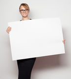 Business woman holding a blank billboard. Stock Photo