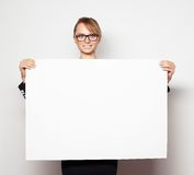 Business woman holding a blank billboard. Stock Photos