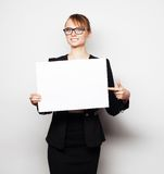 Business woman holding a blank billboard. Stock Image