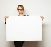 Business woman holding a blank billboard. Stock Images