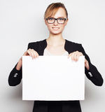 Business woman holding a blank billboard. Royalty Free Stock Photo