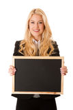 Business woman holding a blank blackboard - teacher Stock Image