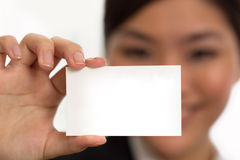 Business woman holding a blank business card Royalty Free Stock Photos