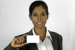 Business woman holding a blank card Stock Image