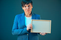 Business woman holding blank diploma certificate Royalty Free Stock Photo
