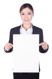 Business woman holding a blank paper sheet isolated on white Royalty Free Stock Image