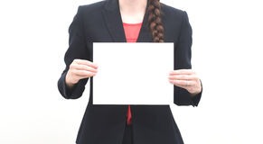 Business woman holding blank piece of paper Stock Images