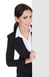 Business woman holding blank placard Royalty Free Stock Photo