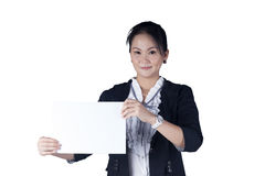 Business woman holding a blank sign board. Business woman in black suit holding a blank sign board, Isolated on white background. Model is Asian woman Stock Images