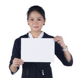 Business woman holding a blank sign board. Business woman in black suit holding a blank sign board, Isolated on white background. Model is Asian woman Stock Image