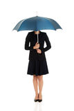 Business woman is holding blue umbrella. Royalty Free Stock Images