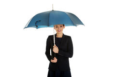 Business woman is holding blue umbrella. Royalty Free Stock Photography