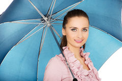 Business woman is holding blue umbrella. Royalty Free Stock Photos