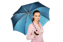 Business woman is holding blue umbrella. Stock Image