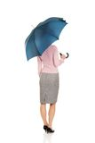 Business woman is holding blue umbrella. Stock Photos