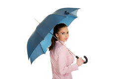 Business woman is holding blue umbrella. Stock Photography