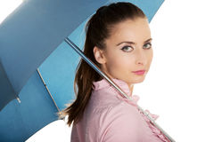 Business woman is holding blue umbrella. Stock Photo