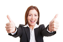 Business woman holding both thumbs Royalty Free Stock Photo