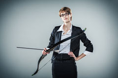 Business woman holding a bow and arrow Stock Images