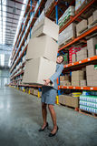 Business woman holding boxes Royalty Free Stock Images