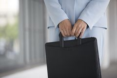 Business Woman holding a briefcase Royalty Free Stock Photography
