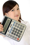 Business woman holding calculator Royalty Free Stock Photo