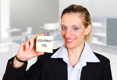 Business woman holding a card Royalty Free Stock Photography