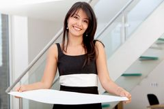 Business woman holding a cardboard Stock Photo