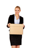 Business woman holding cardboard box Royalty Free Stock Photography