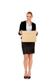 Business woman holding cardboard box Royalty Free Stock Image