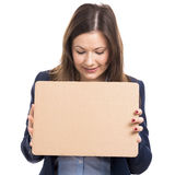 Business woman holding a cardboard Stock Image