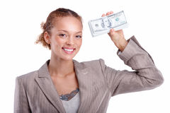 Business woman holding cash cutout on white Royalty Free Stock Image