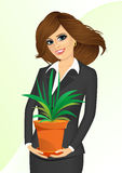 Business woman holding chlorophytum Stock Image