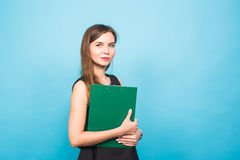 Business Woman Holding A Clip Board on blue background and copy space. Stock Images