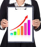 Business woman holding a clipboard with business graph. Chart Royalty Free Stock Image