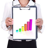 Business woman holding a clipboard with business graph Royalty Free Stock Photography