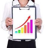 Business woman holding a clipboard with business graph. Chart Royalty Free Stock Photos