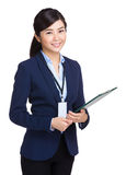 Business woman holding clipboard Royalty Free Stock Photos