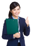 Business woman holding clipboard and thumb up Royalty Free Stock Images